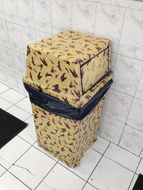 garbage can in journal squara